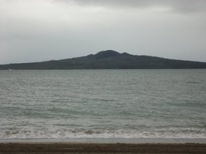 view of rangitoto from mission bay. the volcano is the epicentre of the north shore.
